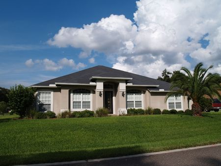 single family home: One story Florida home with a stucco facade.