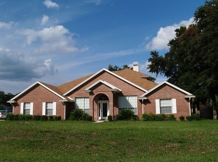 The exter of a one story brick residential home. Stock Photo - 5580803