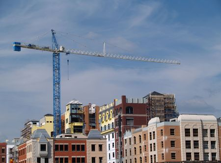 Huge crane on top of a newly constructed building. photo
