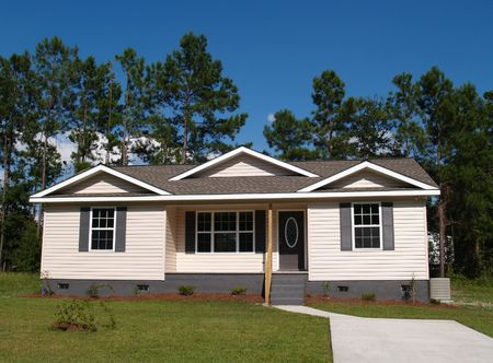 One story residential low income home with vinyl siding on the facade. Stock Photo - 5580802