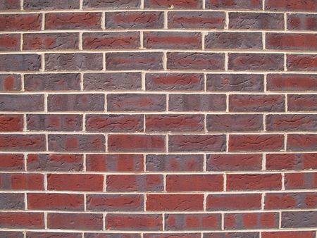 Close up view of red and gray brick exterior wall. photo