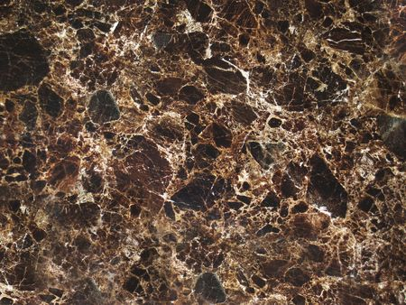 Dark brown grunge cracked marble texture background.