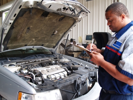 Mechanic Performing a Routine Service Inspection photo