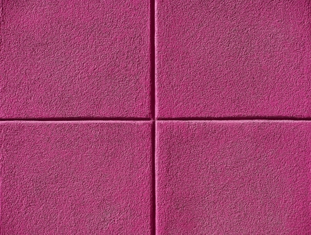 divided: Four pink squares on a concrete wall, powerpoint background and copy space.