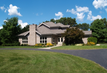 upscale: Single family brick contemporary home with a circle drive. Stock Photo