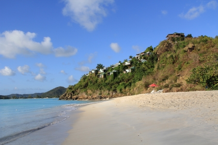 Rental cottages on a hill with view of the Caribbean in Antigua Barbuda near Valley Church Beach.