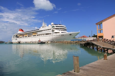 antigua: Cruise ship docked in St. Johns Harbour in Antigua Barbuda with copy space in the sky and on the water. Stock Photo