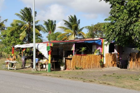 roadside stand: Typical colorful roadside fruit and craft stand or market in Antigua Barbuda Lesser Antilles, West Indies, Caribbean