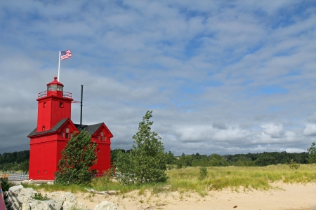 Big Red Lighthouse on the beach in Holland Michigan with copy space  Stock Photo