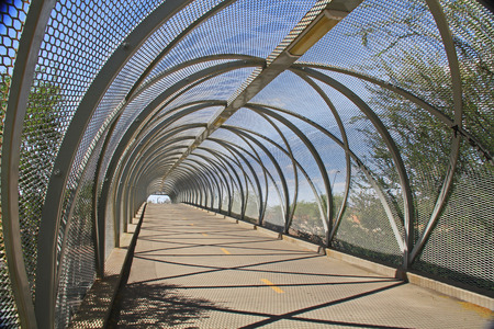 east end: Inside the tail end of the diamondback rattlesnake bicycle and pedestrian covered bridge over Broadway Blvd  at the Barraza-Aviation Parkway, just east of downtown Tucson, Arizona  Stock Photo