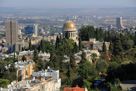View of Haifa, Israel with the beautiful dome of the Shrine of Bab on Mount Carmel and a nuclear power plant in the background. photo