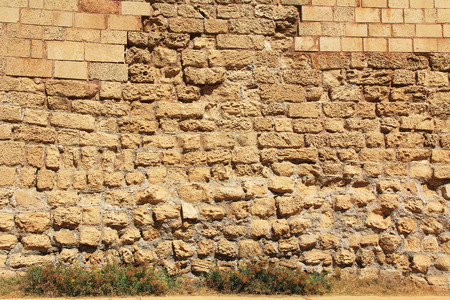 biblical: Stone wall background texture of ruins in Caesarea Maritima National Park, a city and harbor built by Herod the Great about 25-13 BC. The archaeological ruins are on the Mediterranean coast of Israel and it was the administrative capital.