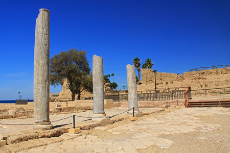 Marble column ruins in Caesarea Maritima National Park, a city and harbor built by Herod the Great about 25-13 BC. The archaeological ruins are on the Mediterranean coast of Israel and it was the administrative capital. photo