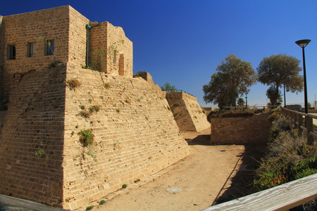 Castle moat ruins in Caesarea Maritima National Park, a city and harbor built by Herod the Great about 25-13 BC. The archaeological ruins are on the Mediterranean coast of Israel and it was the administrative capital. photo