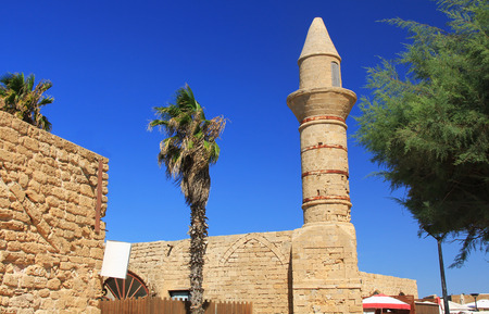 Minaret ruins in Caesarea Maritima National Park, a city and harbor built by Herod the Great about 25-13 BC. The archaeological ruins are on the Mediterranean coast of Israel and it was the administrative capital. photo