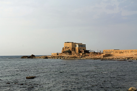 Restaurant by the harbor in Caesarea Maritima National Park, a city and harbor built by Herod the Great about 25-13 BC. The archaeological ruins are on the Mediterranean coast of Israel and it was the administrative capital. photo