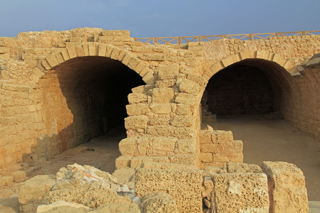 Ruins of storage rooms in Caesarea Maritima National Park, a city and harbor built by Herod the Great about 25-13 BC. The archaeological ruins are on the Mediterranean coast of Israel and it was the administrative capital. photo