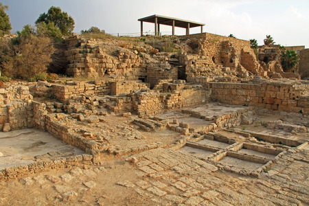 Ruins in Caesarea Maritima National Park, a city and harbor built by Herod the Great about 25-13 BC. The archaeological ruins are on the Mediterranean coast of Israel and it was the administrative capital. photo