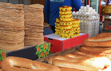 in the open air: An open air market stall with an assortment of breads and eggs in the Christian quarter of Old Jerusalem, Israel.  Also known as the Muristan. Stock Photo