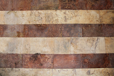 antiquities: Old grunge red and white striped marble wall background texture in the Old City of Jerusalem, Israel.