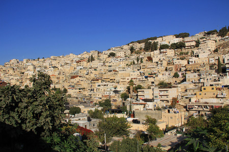 jewish home: Homes on a hillside in Israel as seen from near the old city of Jerusalem. Stock Photo