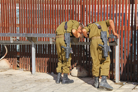 fatigues: Jerusalem, Israel, October 24, 2013, Israeli troops drinking water while waiting to be sworn in at the western wall.