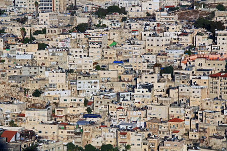 jewish houses: Homes on a hillside in Israel as seen from near the old city of Jerusalem. Stock Photo