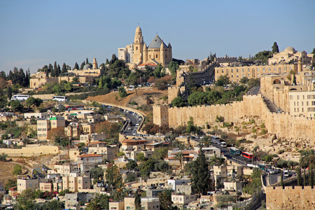 jewish home: Dormition Abby and Old City Walls in a panoramic view of Jerusalem from the Mount of Olives in Israel beside the Kidron Valley.