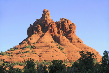 Red rock formation of Bell Rock in Red Rock State Park along Oak Creek Canyon, a riparian habitat in Verde Valley, within Yavapai county, Sedona, Arizona, USA including Coconino National Forest. Stock Photo