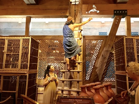 Williamstown, KY, USA - November 3, 2017: Williamstown, KY, USA - November 3, 2017: Noah releasing the dove on Noah's ark replica at the Ark Encounter Theme Park in Williamstown, Kentucky, USA