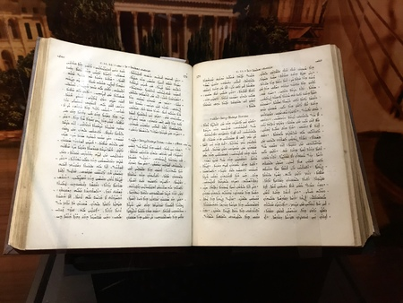 Williamstown, KY, USA - November 3, 2017:  Syriac New Testament from 1826 which mentions Pauls journeys in Syria in Syriac displayed in Noahs ark replica at the Ark Encounter Theme Park in Williamstown, Kentucky, USA Editorial