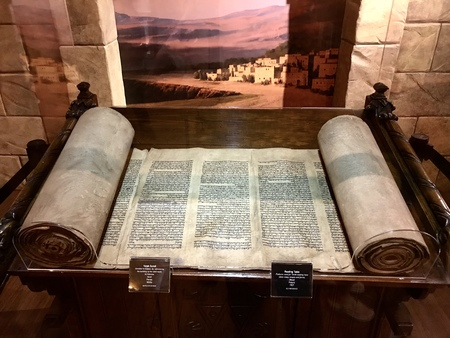 Williamstown, KY, USA - November 3, 2017:  Torah Scroll referencing the building of the tabernacle in Hebrew from the 1800's in Noah's ark replica at the Ark Encounter Theme Park in Williamstown, Kentucky, USA Sajtókép