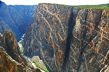 The Gunnison River flowing through Black Canyon of the Gunnison National Park and recreation area at Painted Wall View, near Montrose, Colorado, USA with white sky copy space.
