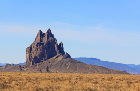 Shiprock rock formation on the Navajo Indian Reservation in northern New Mexico with blue sky copy space.