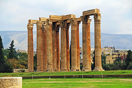 The huge archeological column ruins of the Temple of Olymian Zaus in Athens, Greece with blue sky copy space.