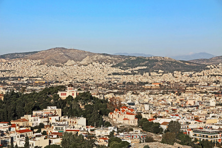 View from Acropolis hill of the city of Athens, the National Observatory and St Marina church on Nymphs hill in Thissio in Athens, Greece. 版權商用圖片