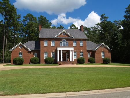 Thomasville, Georgia, USA – September 25, 2009: Large two story red brick residential home with side entry garage. Editorial