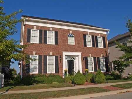 Carmel, Indiana, USA – September 16, 2009: Large two story new brick home built to look like an old historical home.