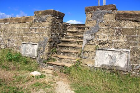 Blue sky copyspace over Old Fort Barrington steps, on the hilltop of Five Islands Peninsula between Deep Bay and St. John's Harbour, Antigua Barbuda Lesser Antilles, West Indies, Caribbean formally, Goat Hill.