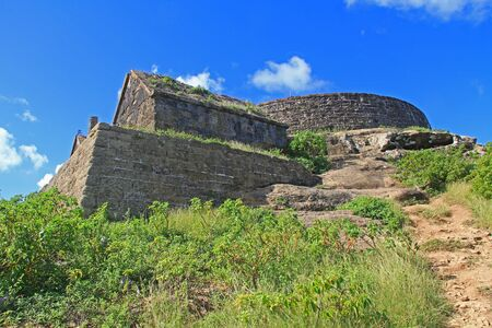 Old Fort Barrington on the hilltop of Five Islands Peninsula between Deep Bay and St. John's Harbour, Antigua Barbuda Lesser Antilles, West Indies, Caribbean formally known as Goat Hill.
