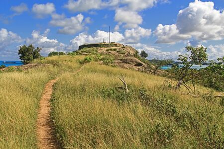 Walking path to Old Fort Barrington on the hilltop of Five Islands Peninsula between Deep Bay and St. John's Harbour, Antigua Barbuda Lesser Antilles, West Indies, Caribbean formally known as Goat Hill. Stock Photo