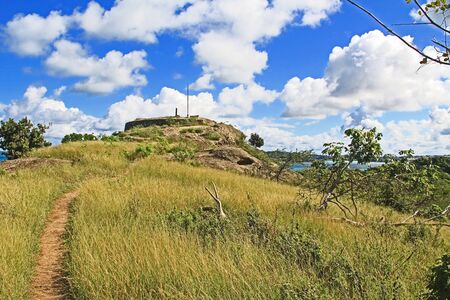 Walking path to Old Fort Barrington on the hilltop of Five Islands Peninsula between Deep Bay and St. John's Harbour, Antigua Barbuda Lesser Antilles, West Indies, Caribbean formally known as Goat Hill. 版權商用圖片