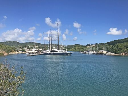 View of boats in English Harbour as seen from Fort Berkeley in Antigua and Barbuda, Caribbean, Lesser Antilles, West Indies with blue sky copy space. 版權商用圖片