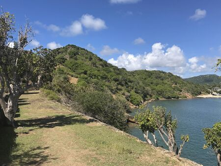 Path leading in and out of Fort Berkeley by English Harbor in Antigua and Barbuda, Caribbean, Lesser Antilles, West Indies with blue sky copy space.