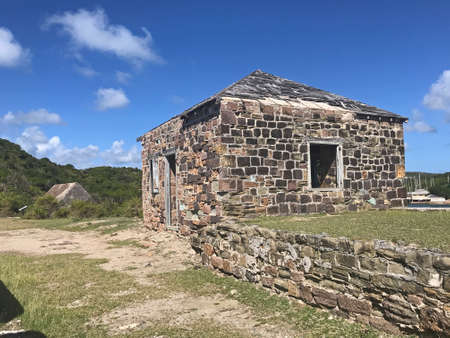Guard House and Powder Magazine at Fort Berkeley in Antigua and Barbuda, Caribbean, Lesser Antilles, West Indies with blue sky copy space.