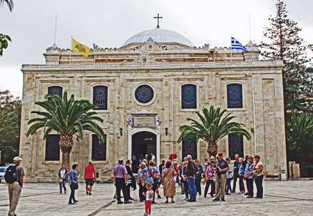 Heraklion, Crete, Greece – October 20, 2018:  Square on August 25th Street with tourists in front of the Church of Ayios Titos in Heraklion, Crete, Greece.