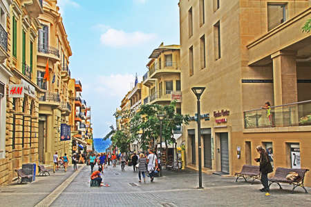 Heraklion, Crete, Greece – October 20, 2018:  Busy main street in the town center, full of shoppers and tourists in Heraklion, Crete, Greece with a view of the Mediterranean Sea and blue sky copy spac