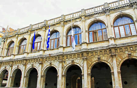 Ornate exterior of the Venetian Loggia housing City Hall on the square of Saint Titus in Heraklion, Crete, Greece with its arched windows and doors and white sky copy space. 版權商用圖片