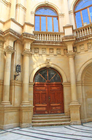 Ornate exterior door of the Venetian Loggia, housing City Hall on the square of Saint Titus in Heraklion, Crete, Greece with its arched windows and doors.