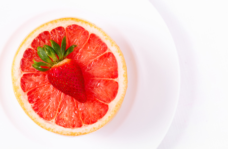 Overhead View of Ruby Red Grapefruit in a White Plate Stock fotó